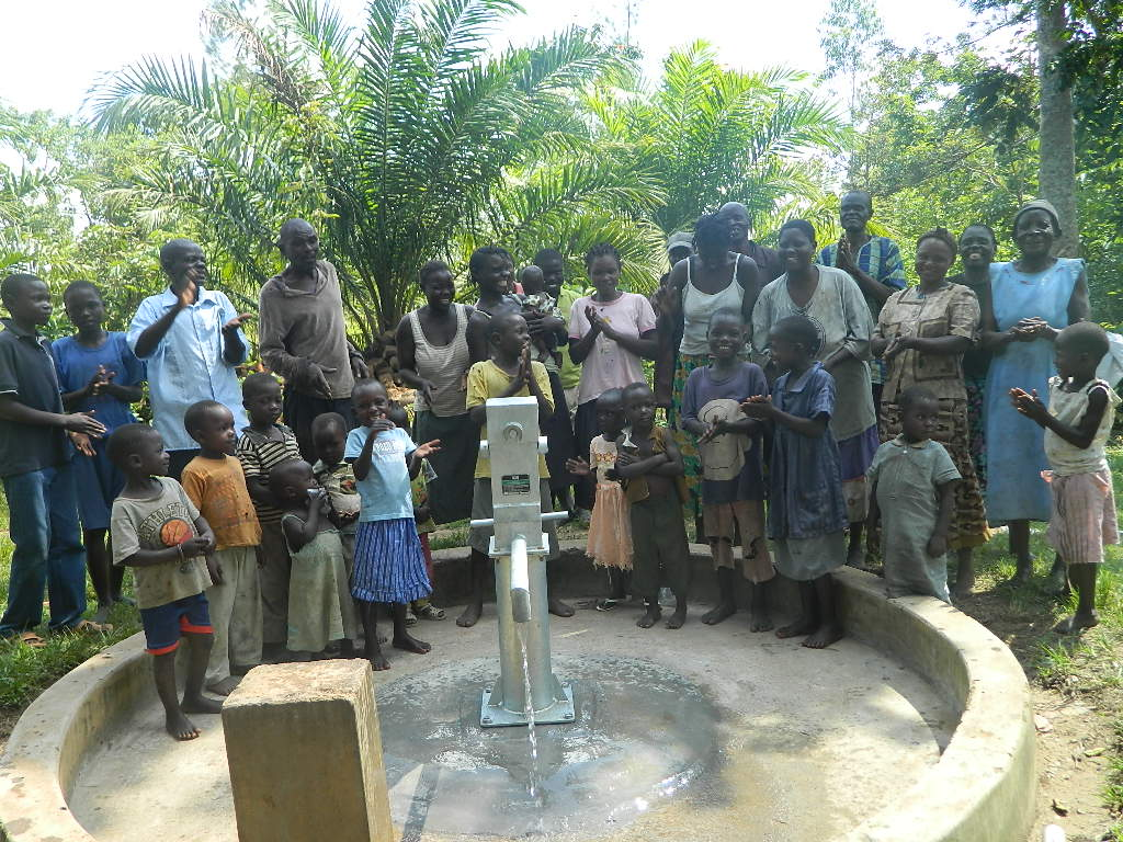 The Water Project : kenya4258-34-eshikulu-members-congratulating-bwp-for-intalling-the-pump-to-their-well