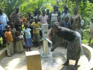 The Water Project : kenya4258-36-handing-over-the-water-to-the-community