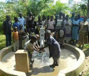 The Water Project : kenya4258-37-handing-the-water-to-eshikulu-community