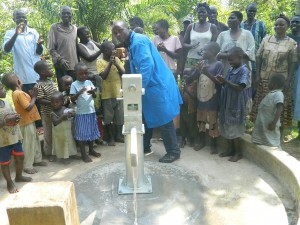 The Water Project : kenya4258-38-protas-machembe-of-bwp-demonstrating-to-the-members-on-how-to-use-the-pump