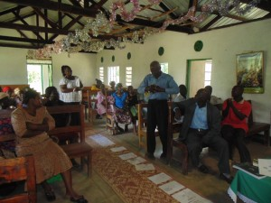 The Water Project : kenya4278-15-alfred-the-church-elder-sharing-his-observation-after-the-whole-exercise-at-elubari-church