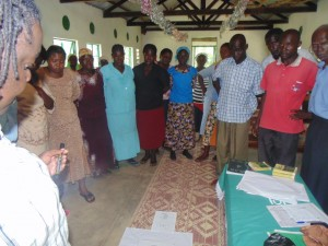 The Water Project : kenya4278-24-the-whole-group-standing-in-a-circle-to-discuss-the-transmission-routes