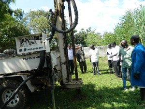 The Water Project : kenya4278-28-settingnof-the-machine-at-elubari-ack-church