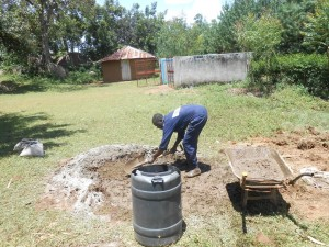 The Water Project : kenya4278-46-joash-one-of-the-community-members-helping-in-mixing-of-concrete-and-cement