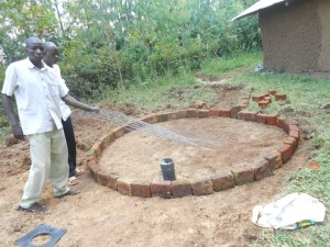 The Water Project : kenya4278-47-laying-the-bricks-and-mesh-wire-before-cement-work