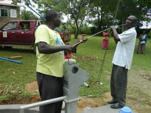 The Water Project : kenya4278-52-02-fixing-the-rising-mail-and-pipes