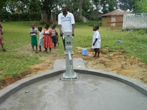 The Water Project : kenya4278-55-05-lawrance-bwp-staff-trying-the-pump