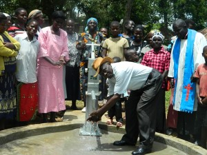 The Water Project : kenya4278-66-elubari-village-elder-enjoying-the-water