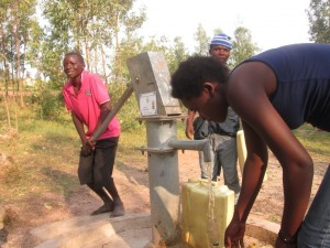 The Water Project : rwanda3080-15-someone-with-clean-water