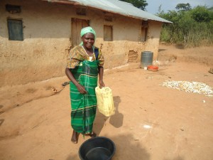 Merisi - Farmer, discussing her newly donated water project in Uganda