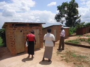 The Water Project : uganda6054-14-inspecting-new-latrines