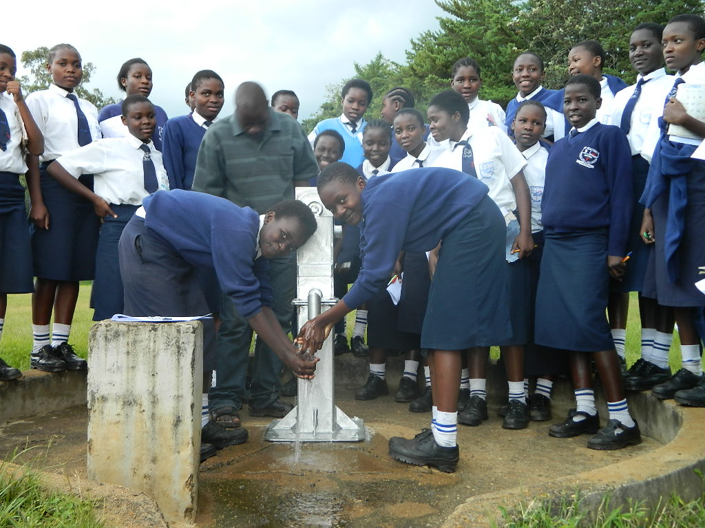 The Water Project : kenya4263-43-st-mary-goretti-girls-handing-over-2