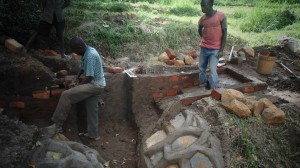 The Water Project : kenya4289-07-bendict-and-other-unskilled-labour-protecting-lihanda-spring-in-lurambi-constituency