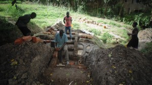 The Water Project : kenya4289-09-bendict-and-other-unskilled-labour-protecting-lihanda-spring-in-lurambi-constituency