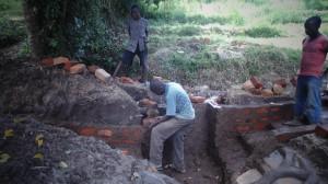 The Water Project : kenya4289-10-artisan-protecting-lihanda-spring-in-lurambi-constituency