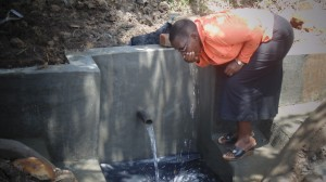 The Water Project : kenya4289-16-janet-taking-water-from-lihanda-spring