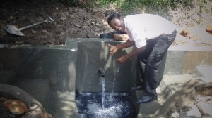 The Water Project : kenya4289-19-victor-with-thump-up-for-work-well-done