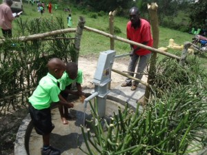 The Water Project : uganda6056-18-caretaker