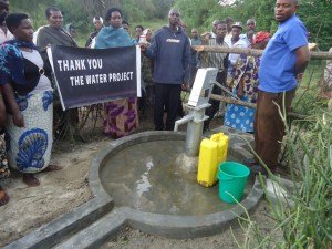 The Water Project : uganda6057-66-some-one-with-clean-water