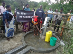 The Water Project : uganda6057-68-some-one-with-clean-water