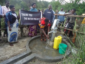 The Water Project : uganda6057-69-some-one-with-clean-water