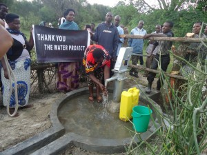 The Water Project : uganda6057-70-some-one-with-clean-water