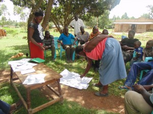 The Water Project : kenya4264-18-market-members-demonstrating-the-disease-transmission-routes