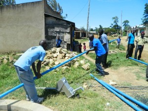 The Water Project : kenya4264-30-fixing-the-pipes