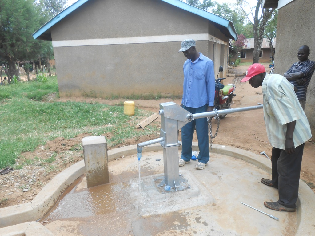 The Water Project : kenya4266-74-nambacha-d-e-b-primary-school-water-flowing