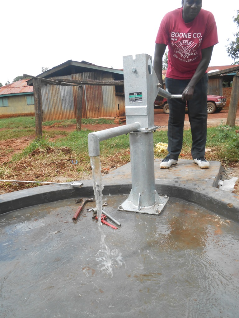The Water Project : kenya4280-77-laboret-boarding-primary-pump-installation