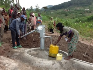 The Water Project : rwanda3083-08-clean-water-flowing