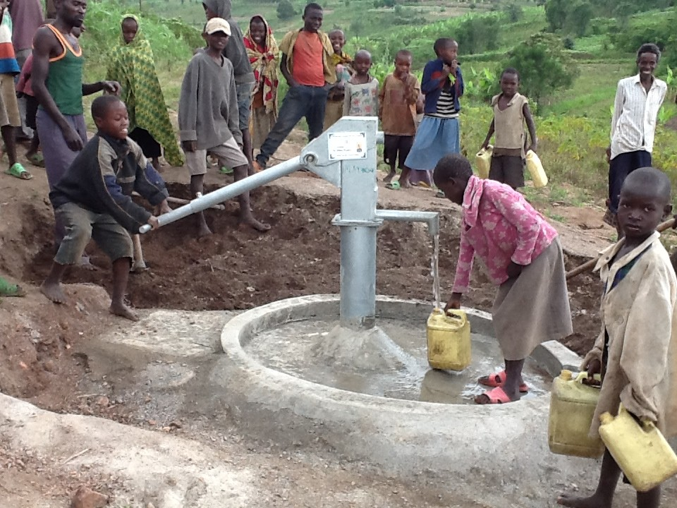 The Water Project : rwanda3083-09-someone-with-clean-water-2
