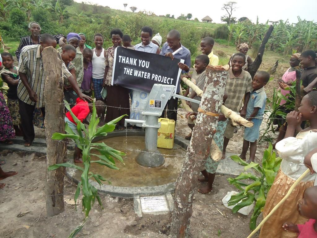 The Water Project : uganda6059-40-peron-using-water