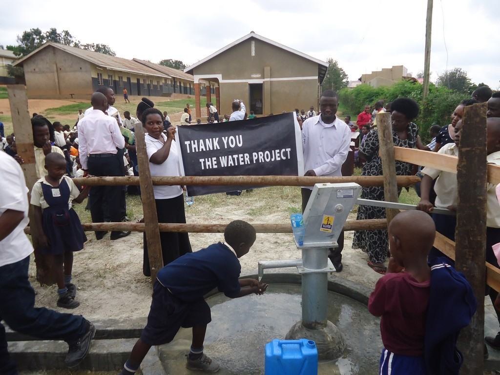 The Water Project : uganda6060-38-person-using-water-2
