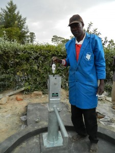 The Water Project : kenya4281-18-inserting-the-foot-valve