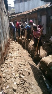 The Water Project : kenya-pamojamashimoni-16-community-cleaning-the-drainage-2