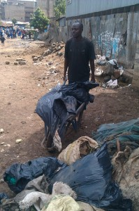 The Water Project : kenya-pamojamashimoni-28-one-of-the-youth-groups-taking-garbage-after-household-collection-2