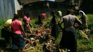 The Water Project : kenya-pamojamashimoni-31-women-from-mashimoni-assisting-in-the-community-clean-up-of-the-settlement-2
