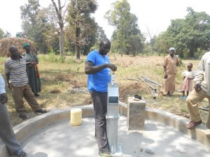 The Water Project : kenya4319-48-inserting-the-footvalve-to-the-well