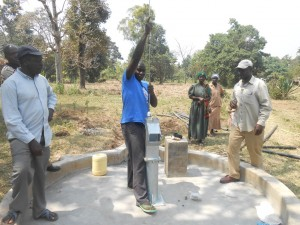 The Water Project : kenya4319-49-inserting-the-plunger-to-the-musidi-well