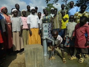The Water Project : kenya4319-51-a-boy-from-the-musidi-community-happy-to-get-the-clean-and-quality-water-2