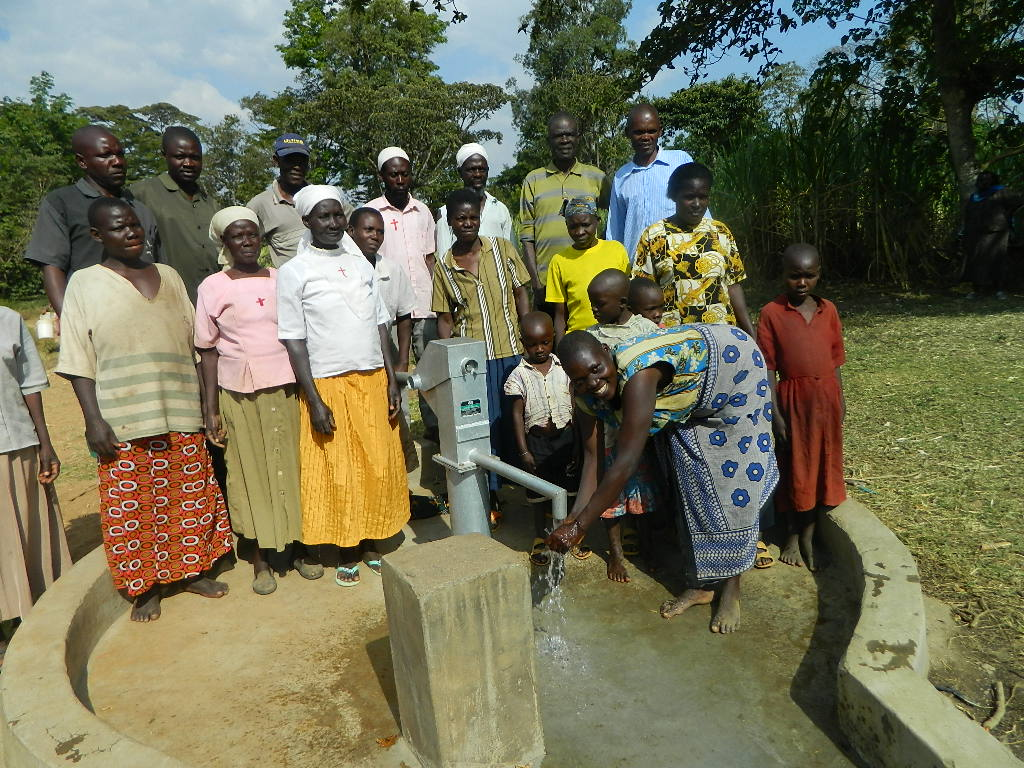The Water Project : kenya4319-53-lina-from-the-musidi-community-happy-to-get-water