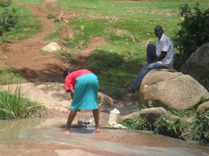 The Water Project : kenya4320-06-utende-current-water-source