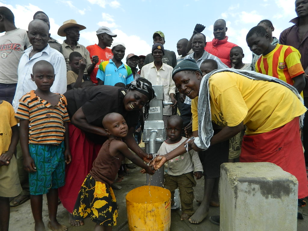 The Water Project : kenya4320-29-the-young-caro-and-the-mother-happy-for-the-clean-water