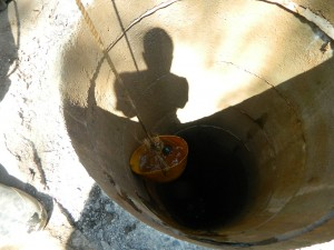 The Water Project : kenya4321-24-fishing-out-the-dirt-from-the-well