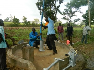 The Water Project : kenya4321-39-rising-main-pipe-installation