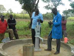 The Water Project : kenya4321-45-installing-foot-valve