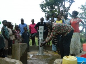 The Water Project : kenya4321-48-chairman-enjoying-clean-water