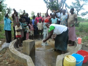 The Water Project : kenya4321-49-community-members-happy-to-get-clean-water