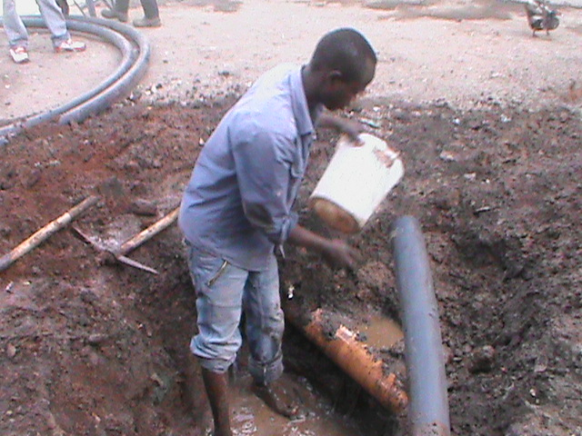 The Water Project : kenya-pamojamashimoni-34-clearing-of-the-drainage-for-water-connection-in-mashimoni